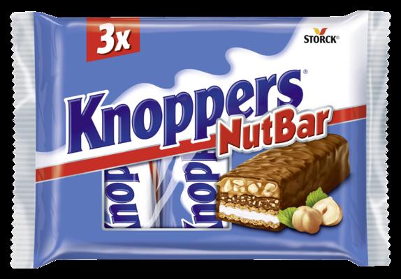 Knoppers NutBar 3 pieces - Oplatky plněné mléčným krémem (14,4 %), nugátovým krémem (14 %), sekanými lískovými ořechy (13,4 %) a měkkým karamelem (22,2 %) máčené v mléčné čokoládě (29,5 %)/ Oblátky plnené mliečnym krémom (14,4%), nugátovým krémom (14%), sekanými lieskovcami (13,4%) a mäkkým karamelom (22,2%) máčané v mliečnej čokoláde (29,5%).