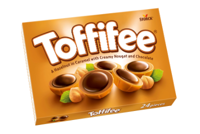 Toffifee - En hasselnød/hasselnøtt (10 %) i karamel (41 %) med nougat (37 %) og chokolade/sjokolade (12 %).