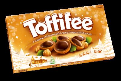 Toffifee Karácsonyi kép 3 x125g - Mogyoró (10 %) karamellben (41 %), mogyorós nugátkrémmel (37 %) és csokoládéval (12 %).