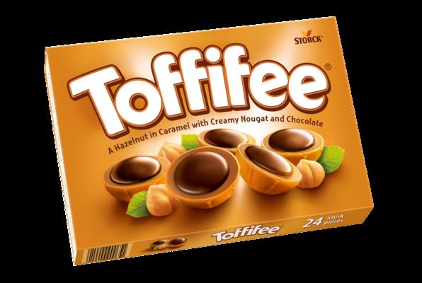 Toffifee 24 pezzi - Una nocciola (10 %) ricoperta di caramello (41 %) con crema alle nocciole (37 %) e cioccolato (12 %).